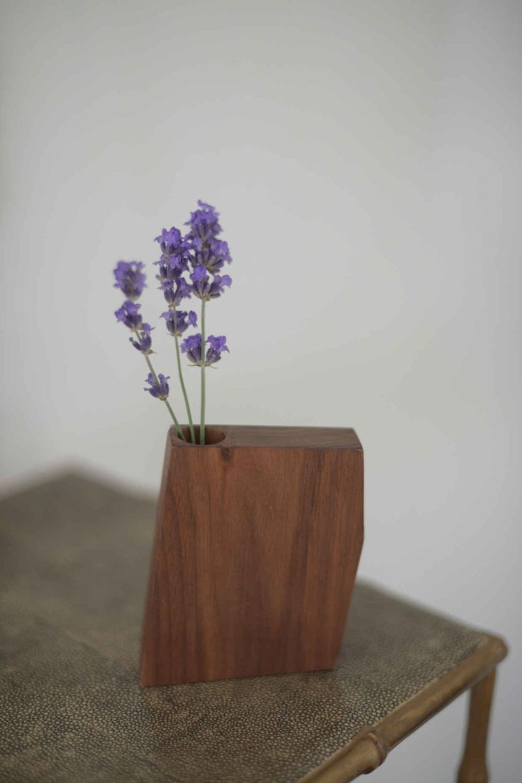 A miniature wooden vase from Boyce Studio that holdslittle buds