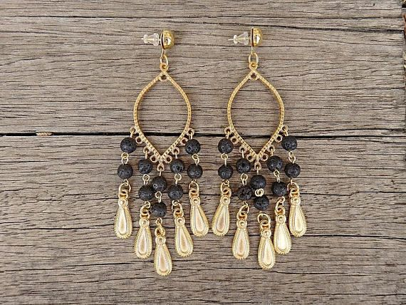 Milan Gold Earrings  Handmade earrings made of gold plated brass elements adorned with black lava gemstone beads and golden drops. We like how they swish playfully as you walk. Show them off with an updo or smooth tresses.     Our Items are handmade and may have slight variations between the same items. Minor imperfections can be possible on leathers, which is what makes them unique!  Colors may vary slightly on your computer screen based on your settings.  *****  The payment method of our…