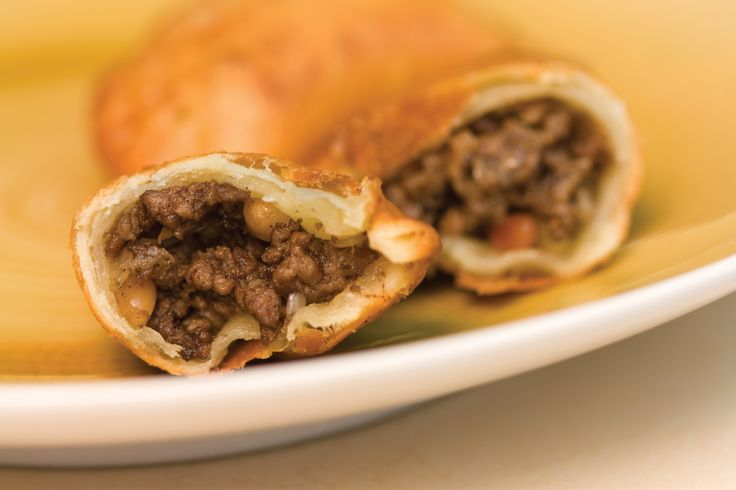 Spiced lamb and pine nut pastries. To receive this recipe and others please purchase my award winning cookbook 'Lebanon to Ghana, the Food I Grew Up With', through the web site shown. This meal is a menu option from my Lebanese Feast private dinner service.