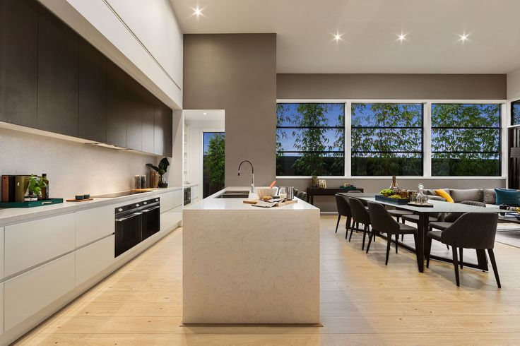 The kitchen is the focal point of the home. A gourmet's delight with its stylish design, modern fit out and the added luxury of a large walk-in pantry. #urbanedgehomes #melbournebuilder #home #homedesign #kitchen #interiors #interiordesign #modernhome #alifewithstyle