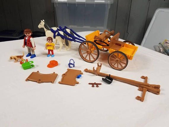 Check out this item in my Etsy shop https://www.etsy.com/listing/581585655/playmobil-horse-and-carriage-set-4186