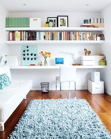 Clever use of space with wall to wall shelving--storage and desk on one wall.
