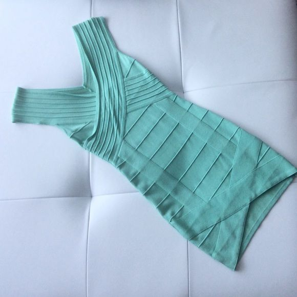 Mint Green Bandage Dress Worn once! Sexy bandage dress with slit detail on the front. HMS Dresses Mini