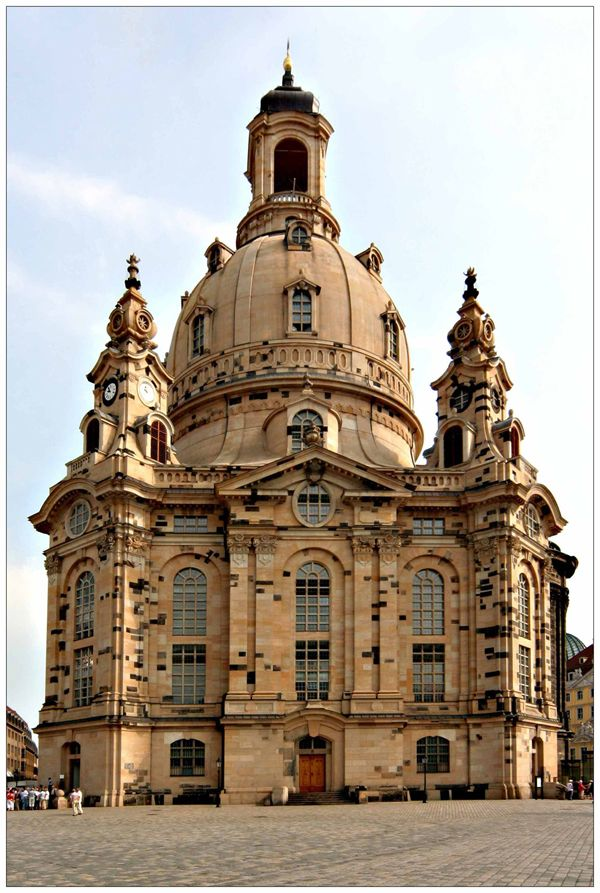 Frauenkirche. Dresden, Germany.  The blackened bricks are ones that were salvaged from the original Frauenkirche, which was bombed at the end of WWII.  They were used whenever possible at part of 'restoring' and rebuilding this jewel.