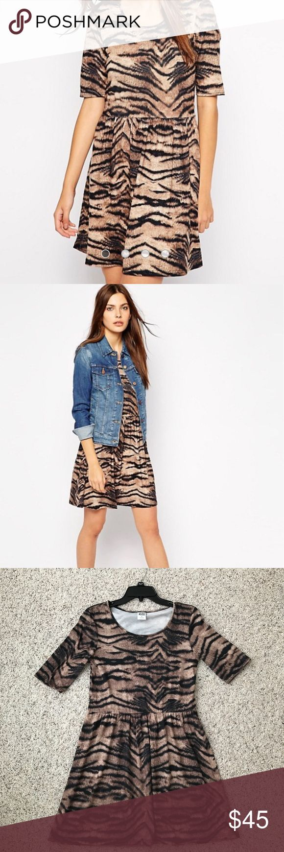 Vero Moda Tiger Print Dress Like new item (worn once). Can fit a size small as well since it is a loose fitting dress. Perfect for LSU game days  Vero Moda Dresses Mini