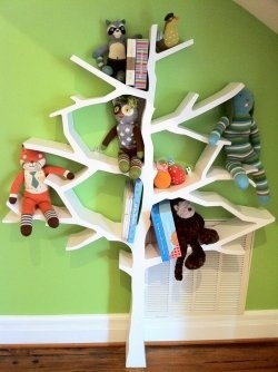 Love this tree bookshelf. It holds up to 100 books!  Way too expensive but may be worth hiring someone to build it for me!