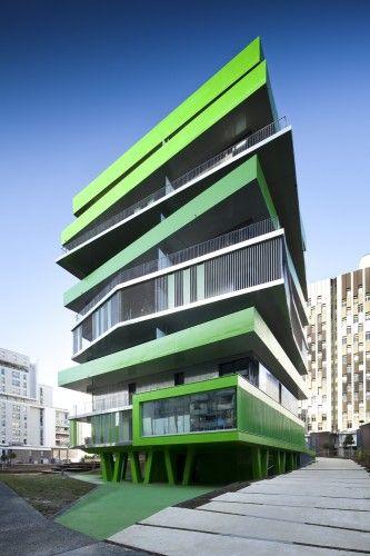 neon green irregular angular layered housing complex design = Villiot-Rapée Apartments |  Hamonic + Masson