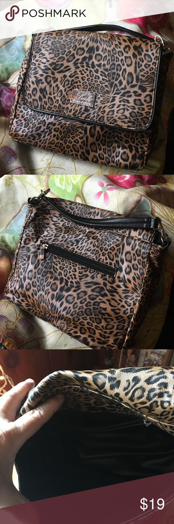 Laila the Essence of Norway purse Cute leopard Laila purse.  Flap has interior magnet for closure.  Interior has zippered pouch.  In really good condition.  There are scratches on nameplate. Laila Bags Satchels