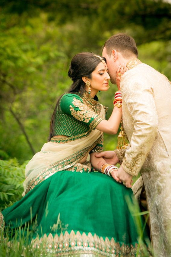 Indian bride in green Sabyasachi lehnga and her groom in a cream colored sherwani | Kumari Photo | Rubies and RIbbon http://kumariphotoanddesign.com/