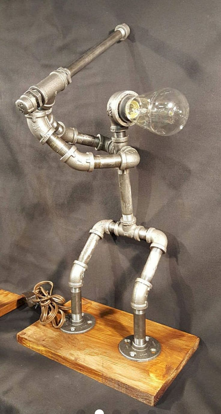 Adorable 35 Creative DIY Industrial Pipe Lamp Design Ideas Robot to Decor Your Home https://roomaniac.com/35-creative-diy-industrial-pipe-lamp-design-ideas-robot-decor-home/