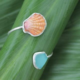 Sunrise shell and blue beach glass bezeled cuff. You can order one at www.oceandreamshawaii.etsy.com