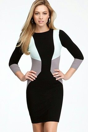 """""""Have You Been Doing P90X?""""  This color-blocked style melts away pounds—or at least creates the illusion of it. The black band down the center widens just below your widest part, making your hips look slimmer, and the pale gray sides at the waist make your obliques look as toned as if you've spent a month doing Tony Horton's Ab Ripper X."""