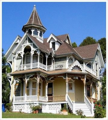 Victorian- multicoloured exterior walls and trim, a widows walk, complex gingerbread trim, towers, multiple tiered rooflines, stained glass work, tall ceilings, hardwood floors, porches and impressive stairways.