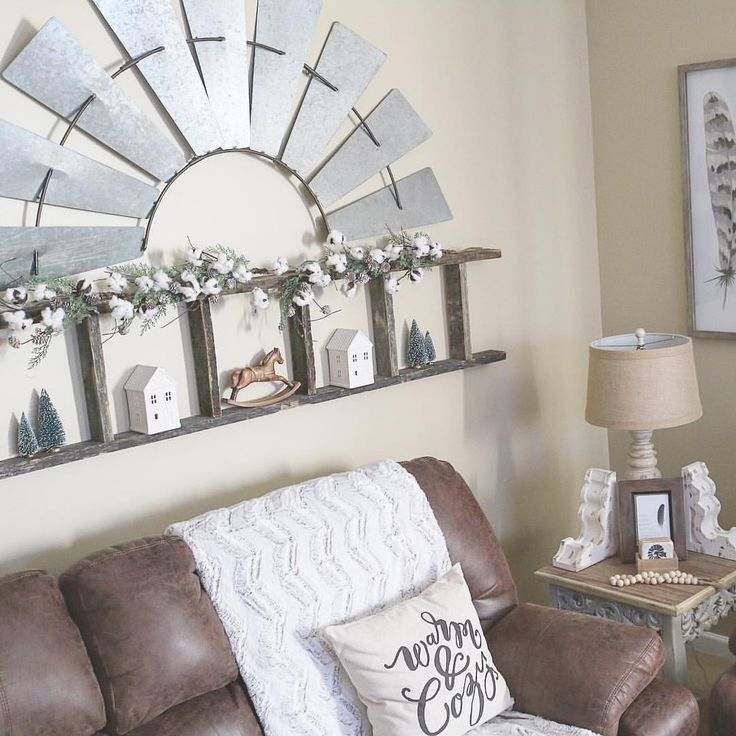 Decor above couch – Repurposed Ladder + Windmill • see this photo by Down Dixie Road (@downdixieroad) on Instagram • Farmhouse Christmas gallery wall above couch reclaimed barnwood farmhouse DIY reclaimed wood decor windmill blade repurposed ladder farmhouse chic rustic living room decor