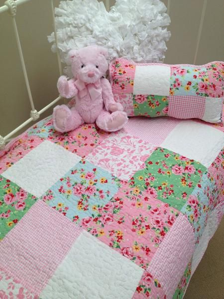 I personally love the Alice design from the Lovely Linen Store. A truly beautiful shabby chic patchwork quilt design. These colours will lift any nursery room and are easy to accessorise with the matching bunting and decorator cushions.  #LovelyLinenStore #ShabbyChic #GirlsNursery #CharlieBears