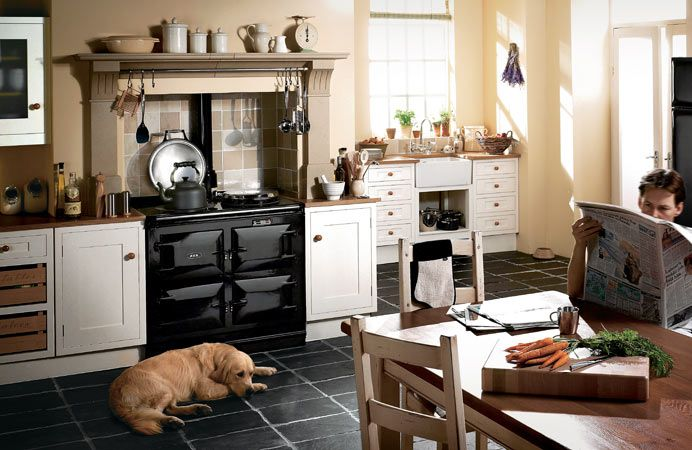 The 3-oven AGA traditional cooker in black with 'Ol Reliable cozied up by its side. #large kitchen