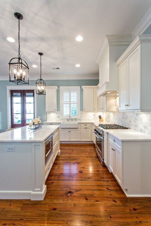 Traditional Kitchen with Flush, Crown molding, Kitchen island, L-shaped, Simple marble counters, High ceiling, Custom hood