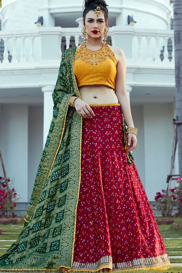 4ac0c69f7b81fd Look youthful in this colorful designer lehenga choli set featuring a red bandhani  lehenga and contrasting yellow halter neck choli printed in white ...