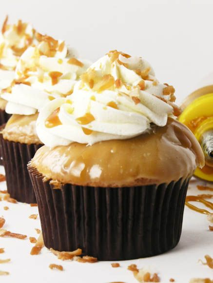 Oh yummmm! Coconut Caramel Cupcakes by Easybaked. Dang, I am never going to lose any weight unless I stop looking at Pinterest dessert goodies! This looks delicious!!