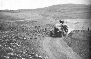 An expedition car near Kalgan—In a region in which, for centuries, camels have been the principal carriers, these motor cars have made possible a rapidity of movement which was formerly undreamed of. Roy Chapman Andrews.