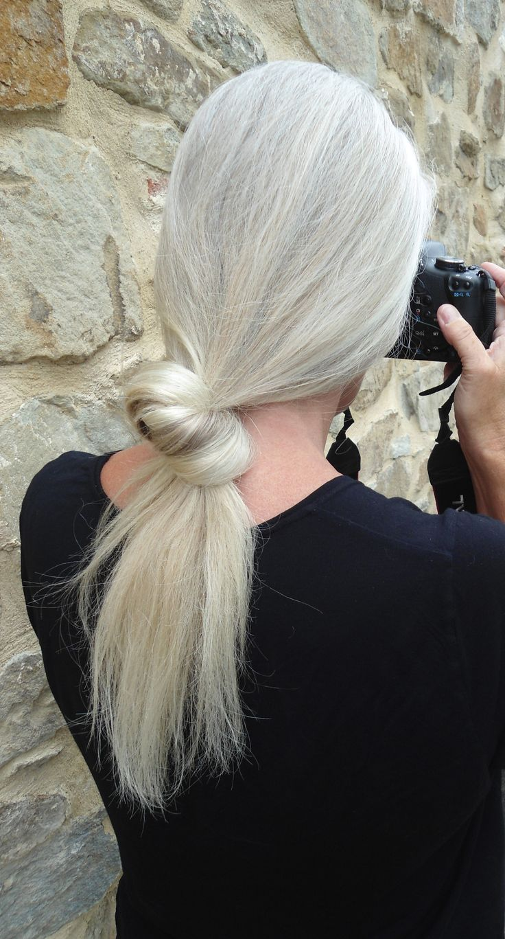 I swear this is my sister! Beautiful grey hair!