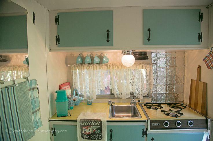 Kitchen In Robin Egg Blue Back Splash Has Hand Embossed