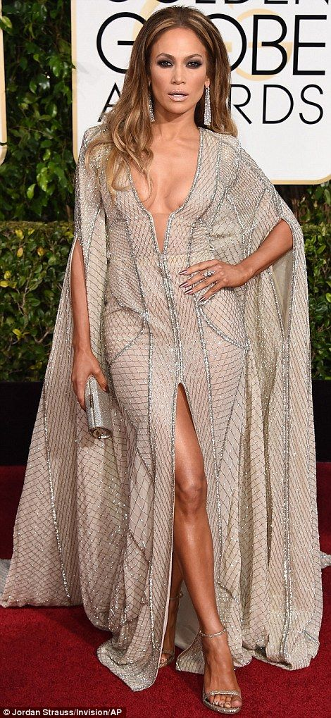 Jennifer Lopez made a plunging entrance in a fabulous pale Zuhair Murad gown at the Golden Globes 2015
