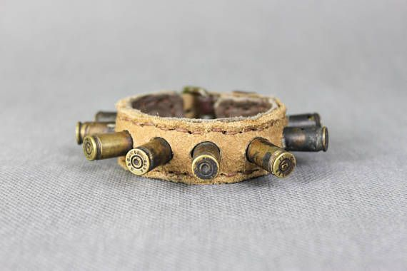Mad Max Fury Road Bracelet - Industrial Wrist Band - Leather Mens Bracelet - Bullet Bracelet - Mens Accessories - Mens Jewelry - Warrior - Rocker - Simple - Raw  Designer of the project is Viola Sychowska founder of Wasted Couture. Leather work is made by Konrad Radziszewski, member of Wasted Couture collective.  This listing is for a MADE TO ORDER bracelet. Please Note: These bracelet pictured above are representative of the style. Individual bracelet will vary in appearance. Hand-made…