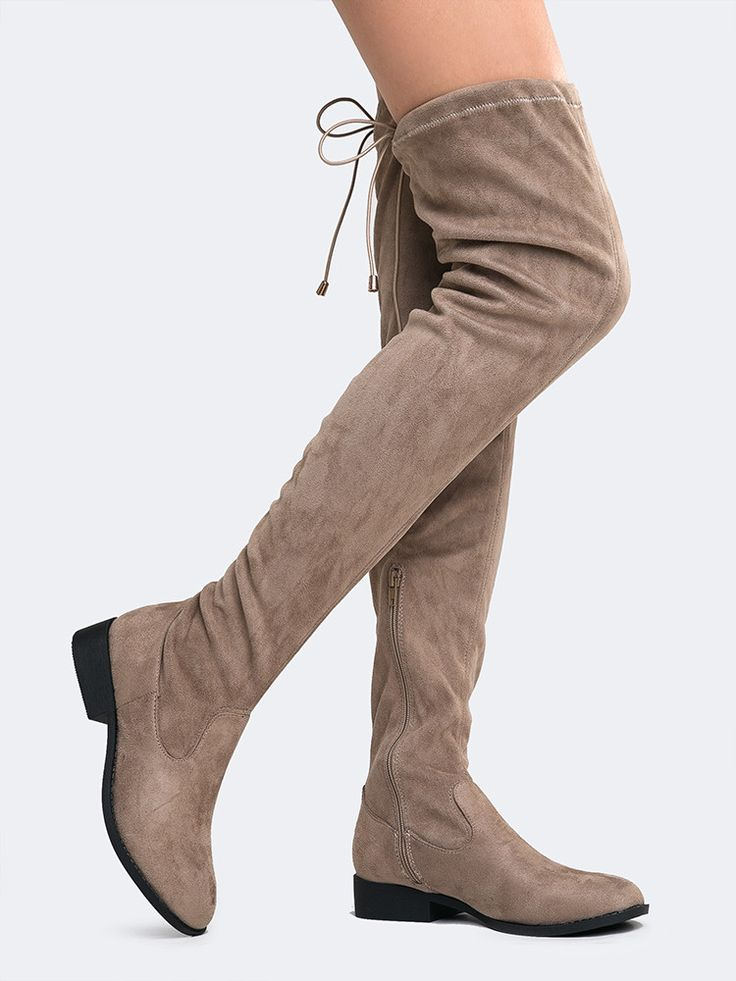- It's always a party with these easy flat thigh high boots! - Over the knee boots have a vegan suede upper that is easy to pull on and a drawstring behind the knee secures the style! - Non-skid sole