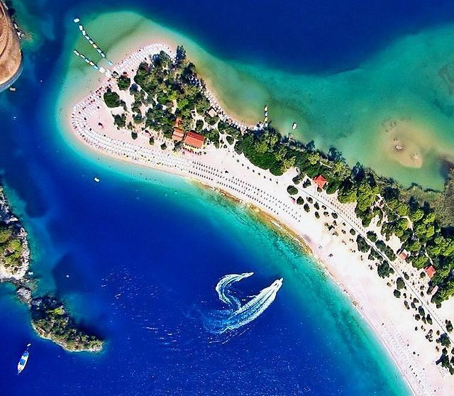 Dream place! So fab!  Ölüdeniz remains one of the most photographed beaches on the Mediterranean. It has a secluded sandy bay at the mouth of Ölüdeniz, on a blue lagoon.