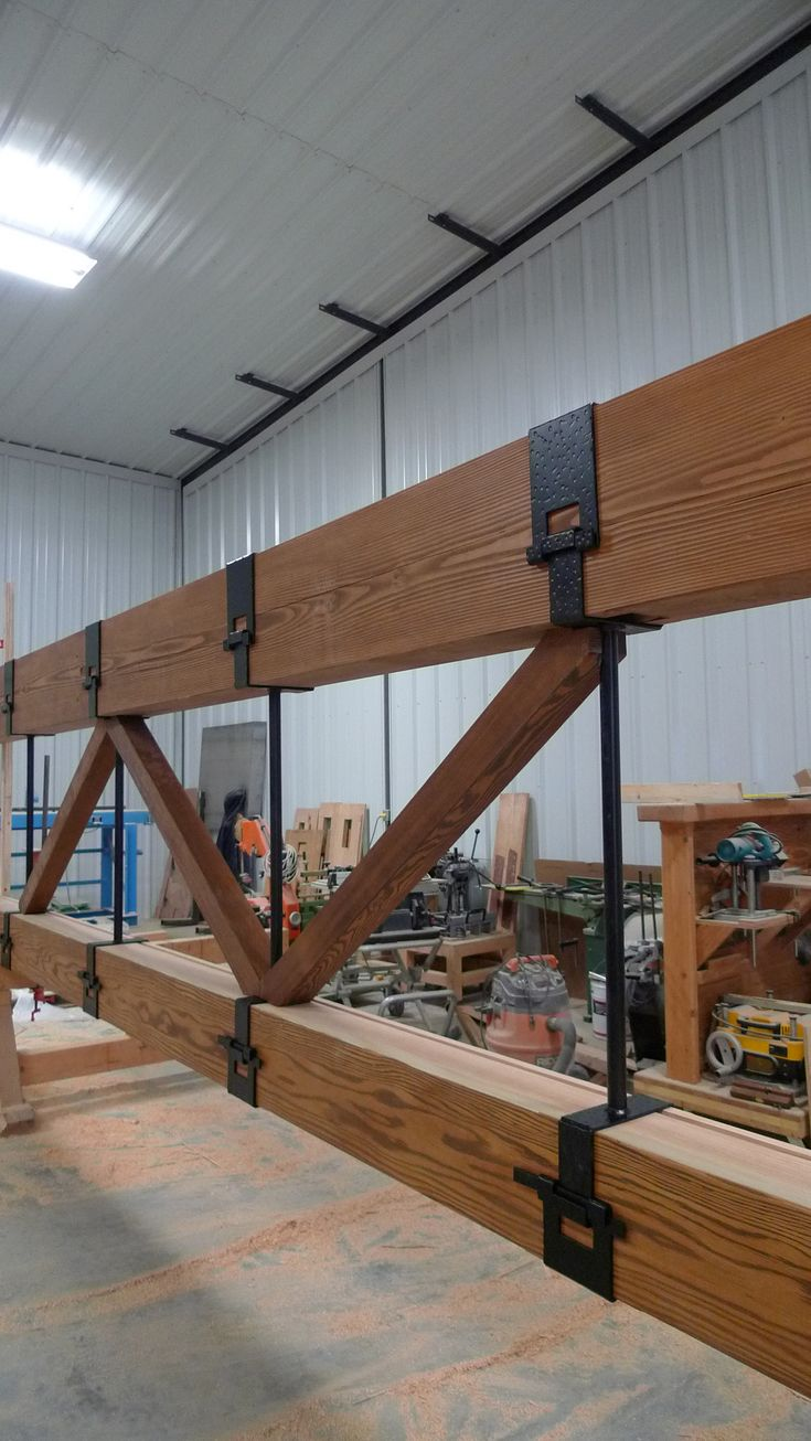 Bridge truss with G style steel strapping by Daizen joinery.