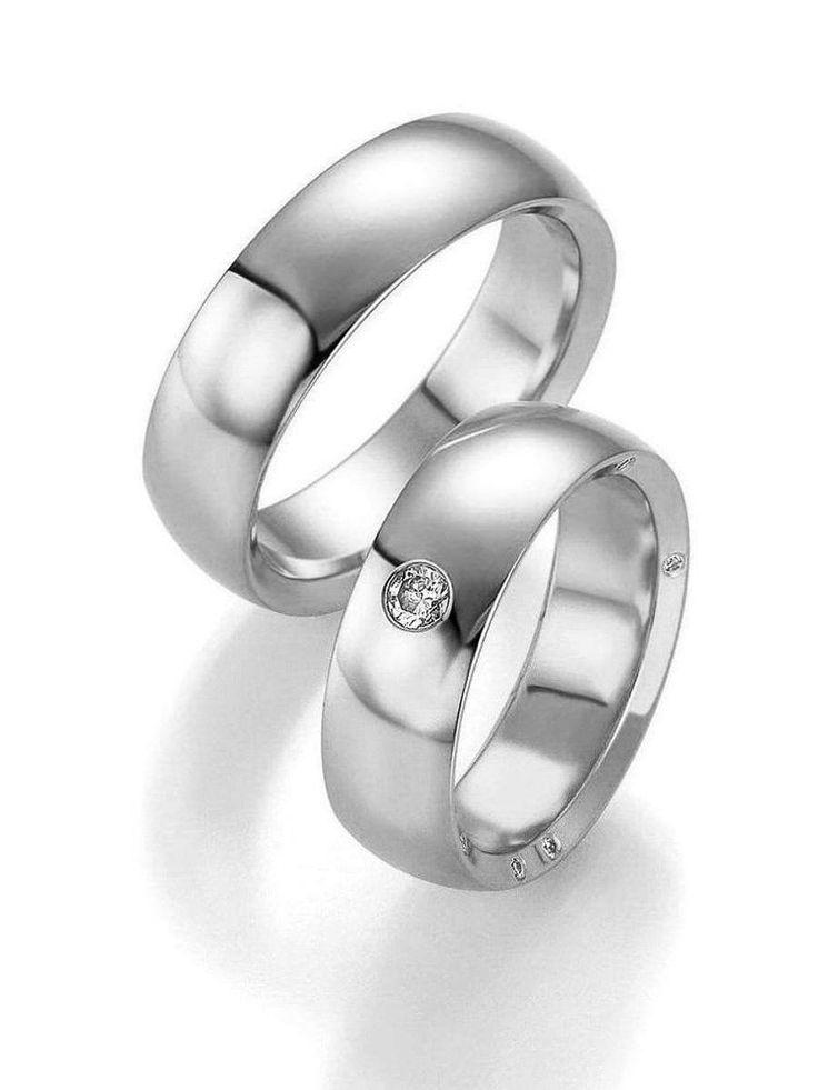 Klassische Platin Hochzeitsringe. Ringbreite: 7,0 mm. Kollektionen: Zeitlose Klassiker. Steingröße & Qualität: ges. 0,0166 ct w/si. Material: Platin. Ringhöhe: 2,4 mm. Oberfläche: glänzend. Lieferzeit: 7-10 Werktage
