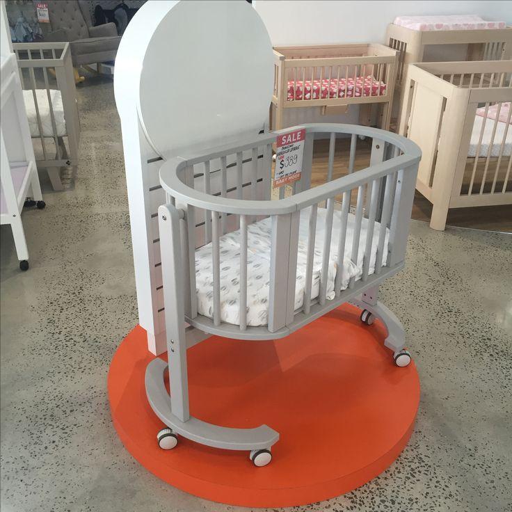 Display stand with slatwall back panel for Babymode Sunshine Vic.