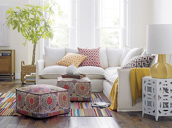 White couch and coloured cushions. Fun way to keep kids off the couch with food.