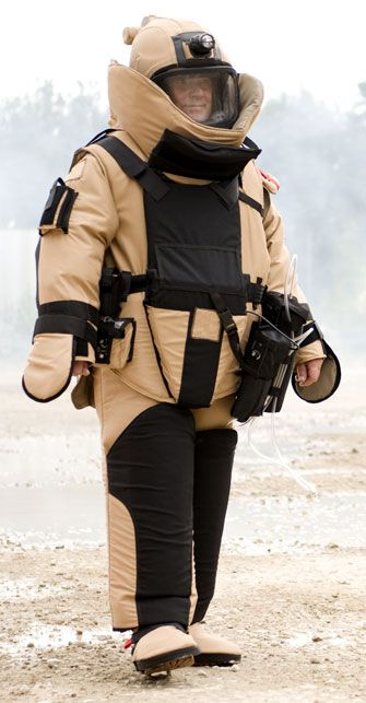 A bomb suit or a blast suit is a heavy suit of body armor designed to withstand the pressure released from a bomb and any projectiles the bomb may produce. It is usually worn by trained personnel attempting bomb disposal. A bomb suit must protect all parts of the body, since the dangers posed by a bomb's explosion affect the entire body. Current designs that are effective are very heavy, bulky and difficult to maneuver in.  Daniel Lim 1B1.