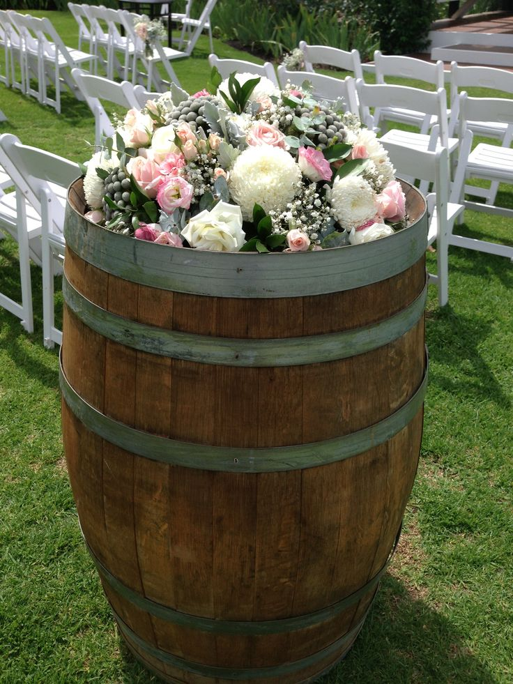 Wine barrel flowers by Scentiment Flowers