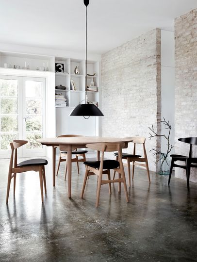 Inspiration for our laundry/project room - painted / whitewashed brick and stained concrete floors.