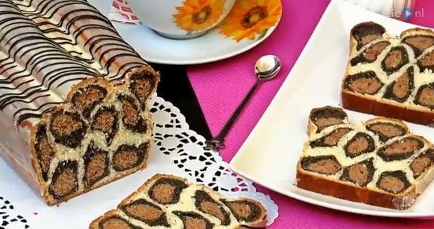 Op het eerste gezicht lijkt het maken van deze cake nogal een uitdaging... ...maar deze video laat zien datdat eigenlijk nogal meevalt.Wacht dus nietlanger en steel de show met deze cake! Laat je ons wel even weten of-ie is gelukt en of-ie lekker was