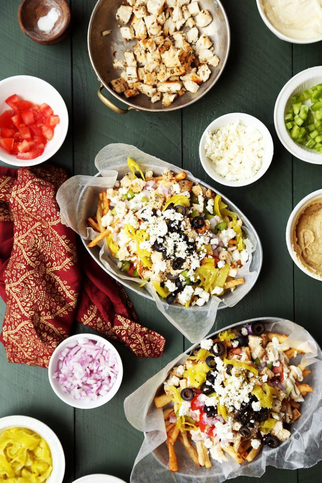 These Mediterranean Gyro Fries are the Greek alternative to Carne Asada Fries! Crispy homemade fries piled with all of your favorite gyro toppings! Tip: I transferred the hummus and aioli into two separate sandwich bags and snipped off the ends, and then used them as pastry bags to squirt them on top of the fries!