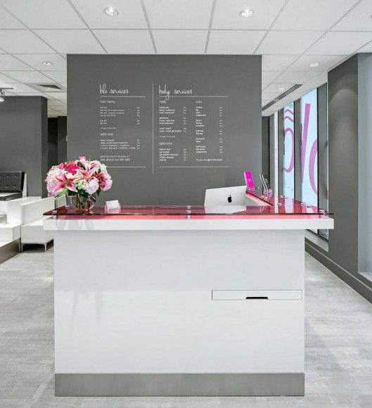 receptionist desk, clean white with pop of color from acrylic or glass topper