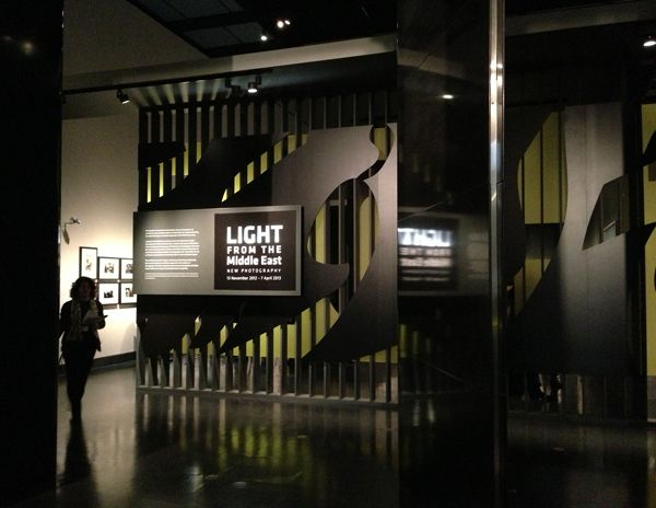 Light From the Middle East: Contemporary photography. Exhibition at the V museum in london. 2D graphics designed by Tarek Atrissi Design. Entrance mural to the typographic space shown in this photo.