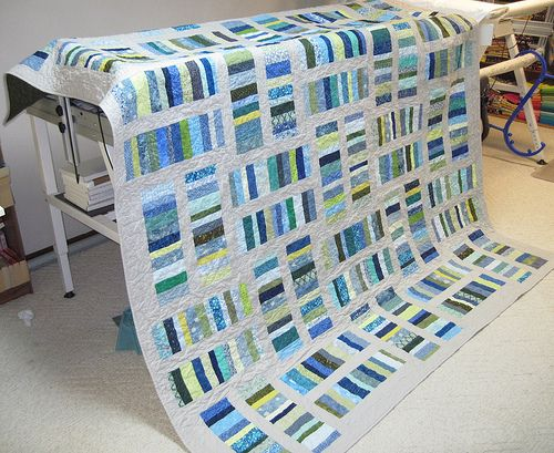 Coin toss quilt. Great way to use up strip scraps.