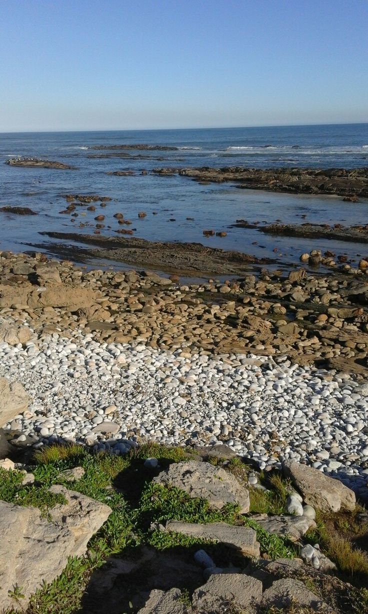 A million pebbles next to the rocks by the sea at Schoenies, P.E.