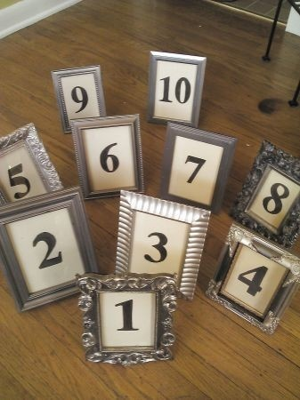 great idea for dollar store frames and mix and match them. then just print out table numbers from the computer. brilliant and cheap! :D