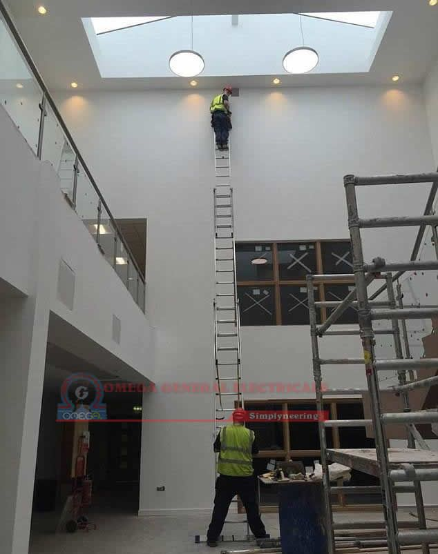 Have you ever tried connecting three ladders to get the job done and then look down? #Emergency_Electrician #Electrical_Contractor #Electrical_Installation #Electrical_Upgrade #Uganda