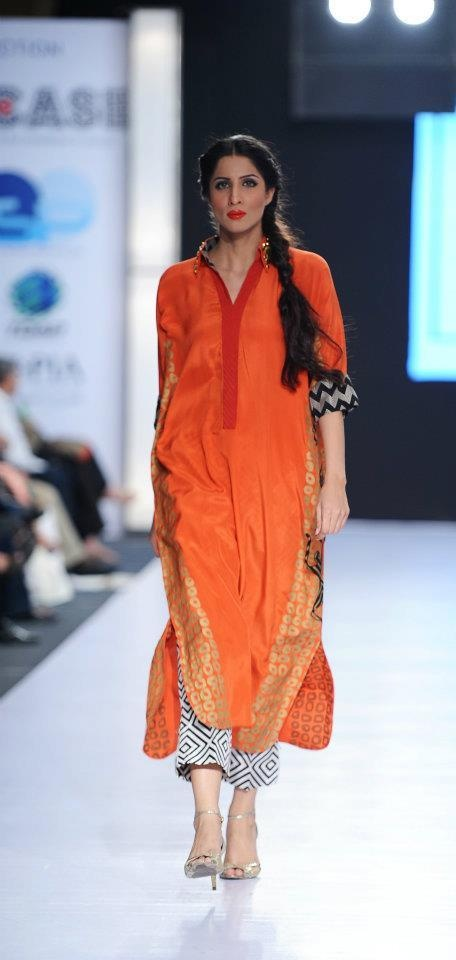 I have liked the kurti style, the printed bottoms and the colour orange. Designer: Sania Maskatiya