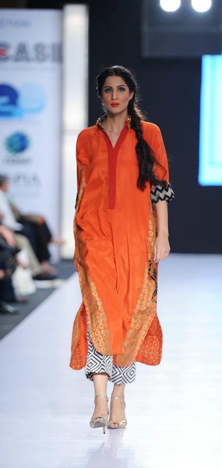 I have liked the kurti style, the printed bottoms and the colour orange. Designer: Sania Maskatiya