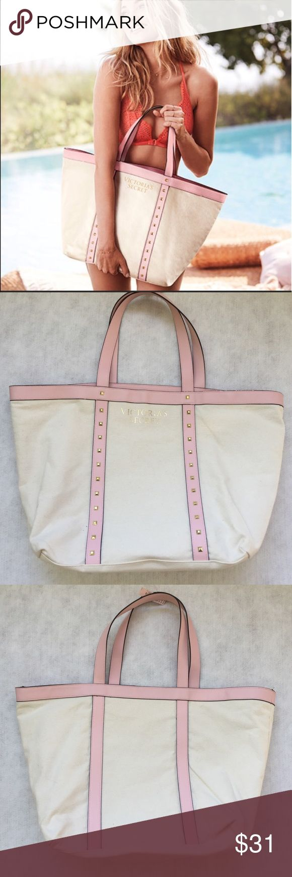Victoria's Secret 2017 Large Canvas Tote Cream canvas and light pink faux leather with gold studding. Black interior. A couple loose threads on one handle and tiny flaws in the black leather trim (see pictures); NWT and never used! Great carryall for errands or beach Victoria's Secret Bags Totes