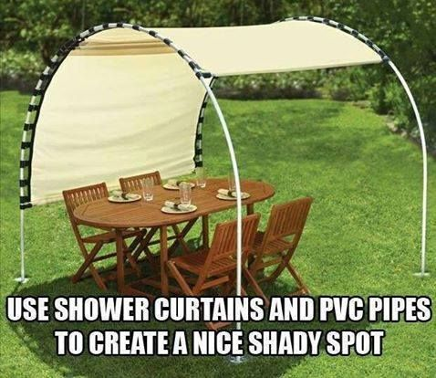 DIY budget shade. Paint the pvc and find a prettier curtain. Great temporary shade.