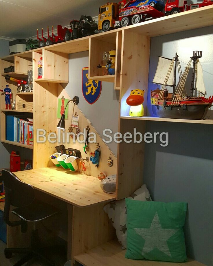Diy desk, shelves, benches with storage boxes under.